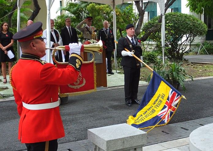 Richard Holmes, the RBL Thailand Standard Bearer, lowering the Legion Standard during the Last Post.