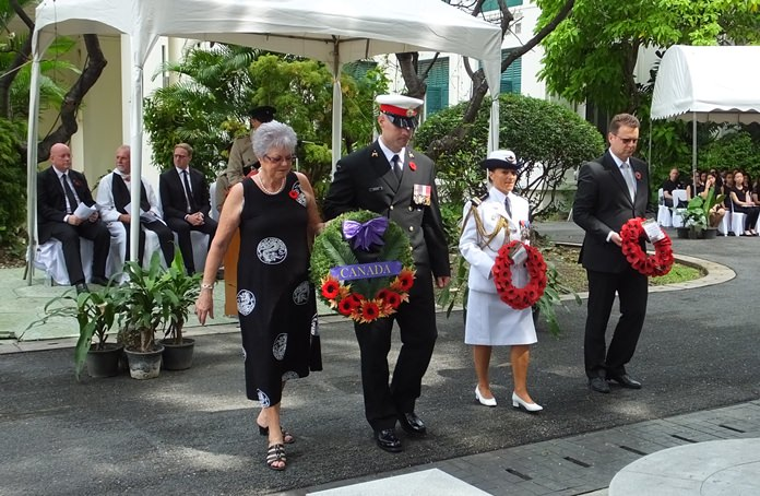 Members of the Canada Embassy present a heartfelt wreath.