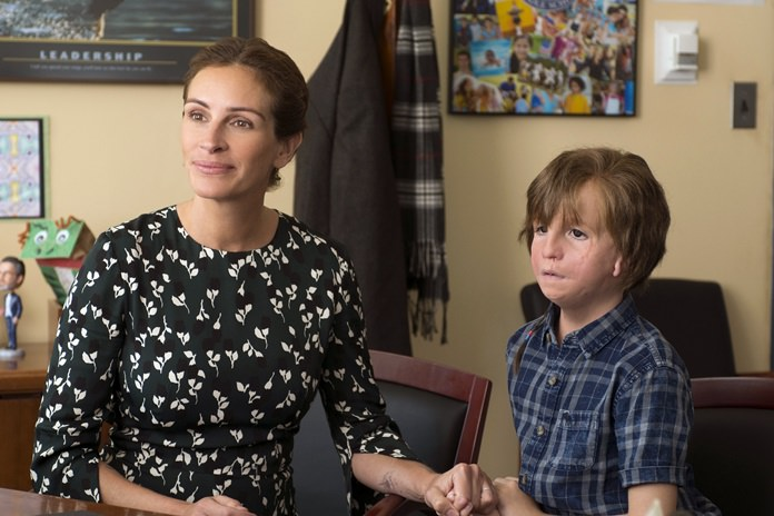 """This image shows Jacob Tremblay, right, and Julia Roberts in a scene from """"Wonder."""" (Dale Robinette/Lionsgate Films)"""