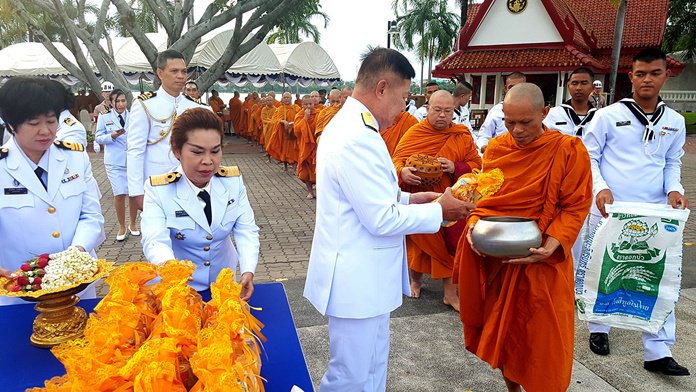 Vice Adm. Sukiti Sa-ngiemphong leads officers, enlisted personnel and local government officials in giving alms to 89 monks from nine area temples at Prince Chumphon Public Park to make merit for Father's Day.