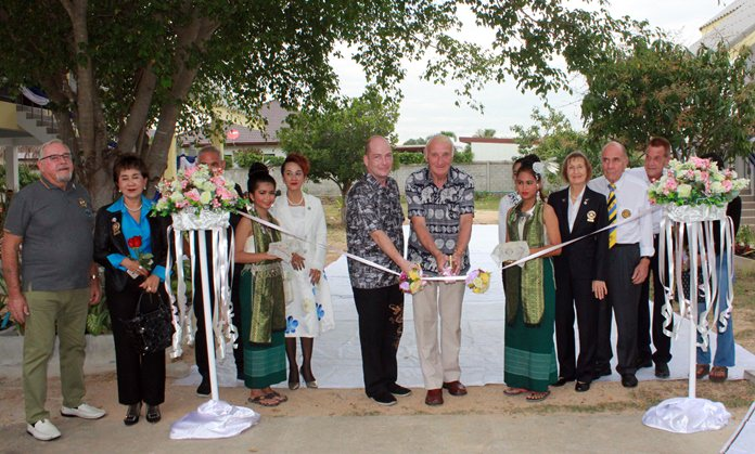 Guest of honor David Ramsy cut the ribbon to officially open two new dormitories to ease crowding at the Child Protection and Development Center.