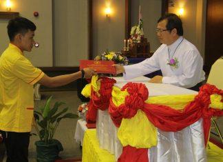 Father Michael Picharn Jaiseri presented the sixty nine graduation certificates.
