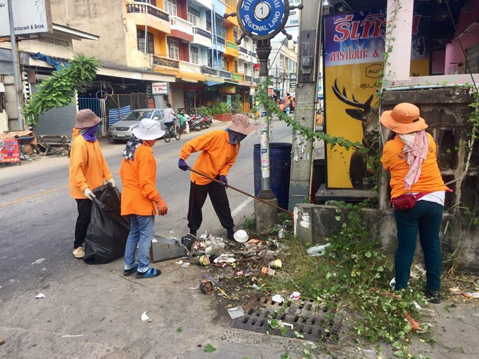 Workers from Pattaya's Environment Department clean up Soi Land Office to honor Father's Day.