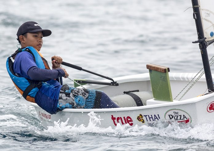 A young Optimist sailor hones his skills during the Phuket regatta.