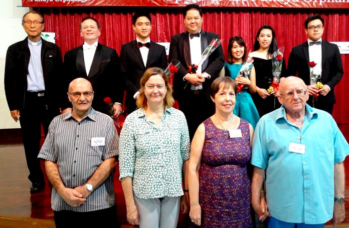 The singers of the Grand Opera Thailand in the back (Father Michel is far left) and the concert organizers in front.
