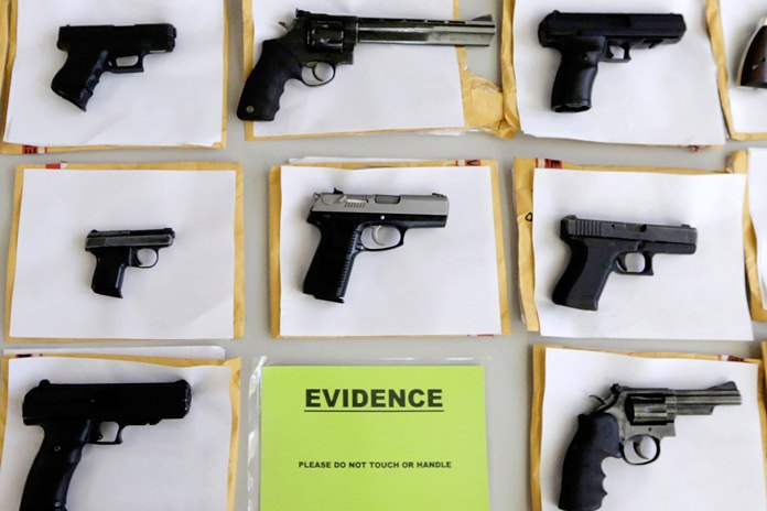 In this July 7, 2014 file photo, Chicago police display some of the thousands of illegal firearms confiscated during the year. In a government report released on Friday, Nov. 3, 2017, the U.S. rate for gun deaths has increased for the second straight year, following 15 years of no real change. (AP Photo/M. Spencer Green, File)