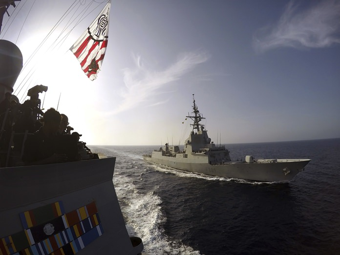 In this Oct. 5, 2016, photo released by the U.S. Navy, the Spanish Navy frigate Alvaro de Bazan, right, cruises alongside the destroyer USS Carney, left, off the coast of Rota, Spain, in the Mediterranean Sea. Bath Iron Works in Bath, Maine, USA, said in November 2017 it is partnering with the Spanish builder of the Alvaro de Bazan on a new design for up to 20 frigates for the U.S. Navy. (Weston Jones/U.S. Navy via AP)