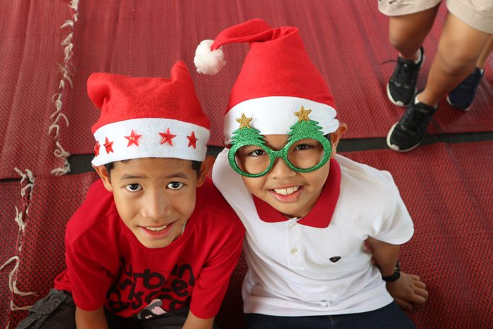 Two young GIS students got dressed up for the Christmas Fair.