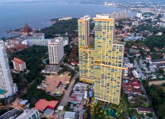 An aerial photo of the two tall towers glistening like jewels overlooking Pattaya bay.