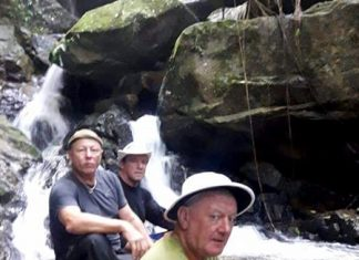 The scribe and climbing pals pause next to a waterfall during their ascent of Soi Dao mountain.