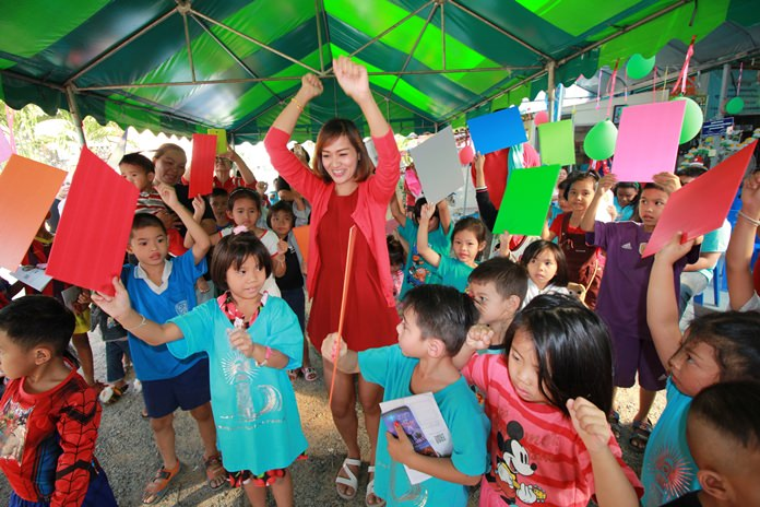 Soi Korphai children are laughing and smiling as the Christian Club plays games with them to win prizes.