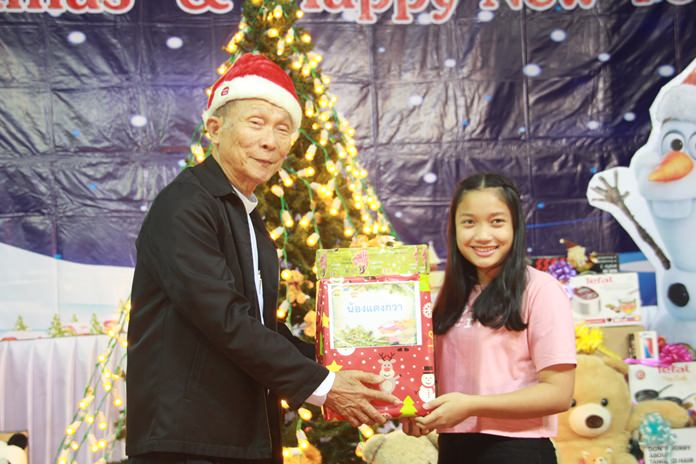 Fr. Weera Pangrak, director of the Pattaya Orphanage gives out presents to the children.