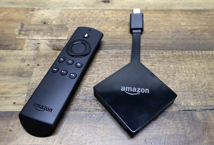 This file photo shows an Amazon Fire TV streaming device with its remote control. On Tuesday, Dec. 5, 2017, Google announced plans to pull its popular YouTube video service from Amazon's Fire TV and Echo Show devices in an escalating feud that has caught consumers in the crossfire. (AP Photo/Elaine Thompson, File)