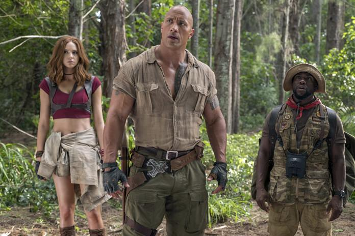 "This image shows (from left) Karen Gillan, Dwayne Johnson and Kevin Hart in a scene from ""Jumanji: Welcome to the Jungle."" (Frank Masi/Sony Pictures via AP)"