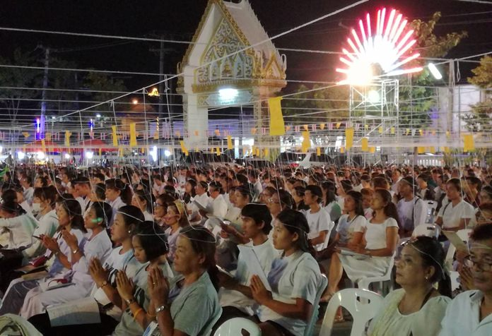 People pack into Wat Satawat to meditate, hoping to create good Karma.