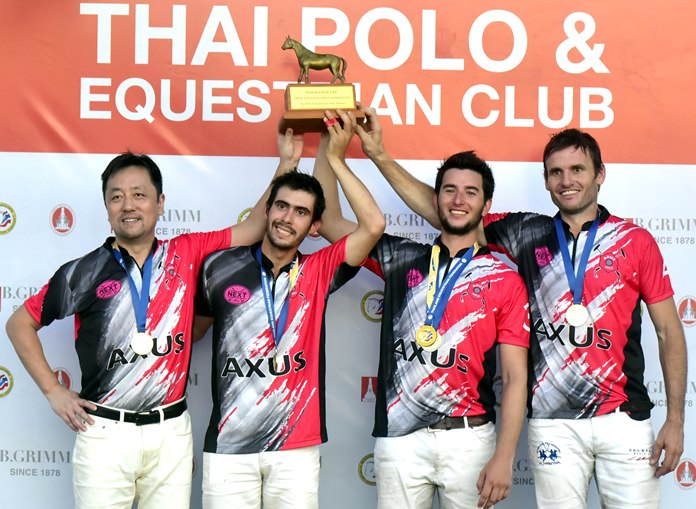 Axus team members celebrate on the podium after winning the Thai Equestrian Federation Cup at the Thai Polo & Equestrian Club in Pattaya, December 31.