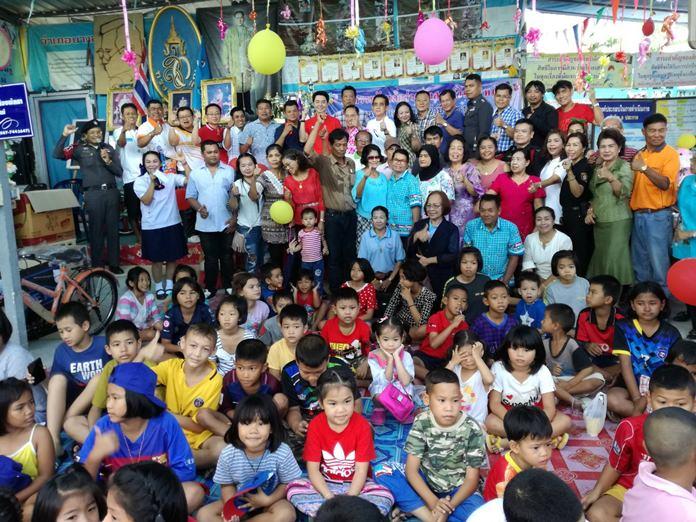 Former Chonburi MP Poramet Ngampichet and Wirath Joyjinda, the community leader of Soi Korphai open the Soi Korphai Children's Day activities.