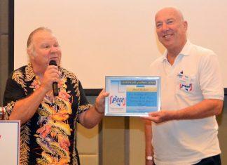 MC Roy Albiston presents Brad Walker with the PCEC's Certificate of Appreciation.