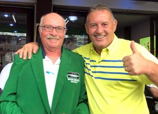 Phil Davies (right) presents a green jacket to John Anderson.