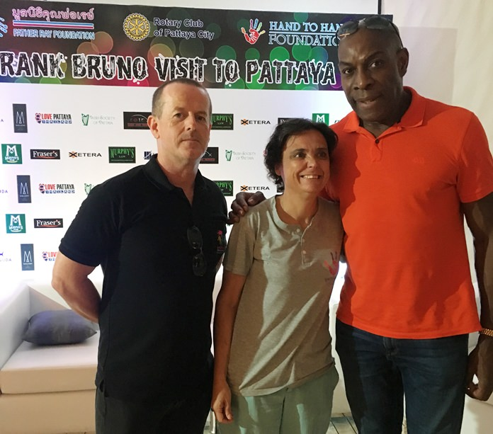 At the press conference, Frank Bruno meets Margie from Hand to Hand and Derek from the Father Ray Foundation.