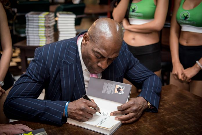 Before the session ended, Frank took his time to sign all books that were sold on the night.