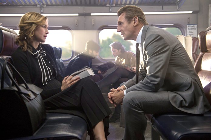 "This image shows Vera Farmiga (left) and Liam Neeson in a scene from ""The Commuter."" (Jay Maidment/Lionsgate via AP)"