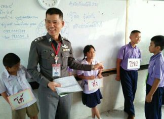 Pol. Capt. Prasom Boonman teaches the Drug Abuse Resistance Education program in Pattaya schools.