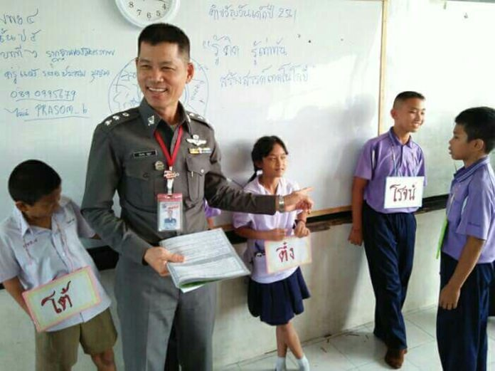 Pol. Capt. Prasom Boonman teaches the Drug Abuse Resistance Education program in Pattaya schools.