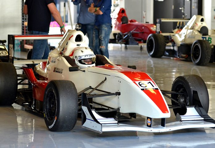 The young Pattaya racer waits in the garage at the Yas Marina circuit in Abu Dhabi.