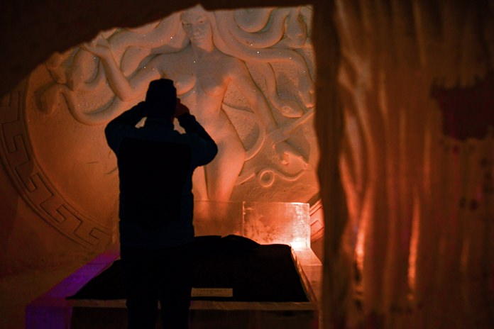 A visitor stands inside a Game of Thrones-themed ice hotel in Kittila Finnish Lapland on Sunday Jan. 14, 2018. (Aku H'yrynen/Lehtikuva via AP)