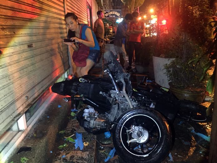 A wrong-way driver was critically injured when he collided with motorcycle taxi carrying a tourist and a Thai woman.