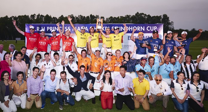 Royal Pahang of Malaysia (centre rear) hold the trophy as they pose with competing teams and supporters at the conclusion of the 2018 Carrier - B.Grimm Thai Polo Open, January 20 at the Thai Polo & Equestrian Club.