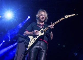 In this Oct. 24, 2015 file photo, Glenn Tipton of Judas Priest performs in San Bernardino, Calif. (Photo by Paul A. Hebert/Invision/AP)