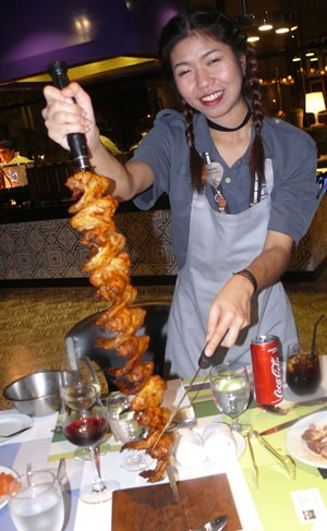 The happy lady with the skewers.