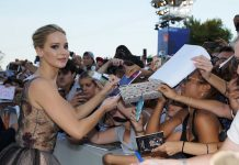 "In this Sept. 5, 2017, file photo, actress Jennifer Lawrence signs autographs at the premiere of the film ""mother!"" at the 74th edition of the Venice Film Festival in Venice, Italy. (AP Photo/Domenico Stinellis)"