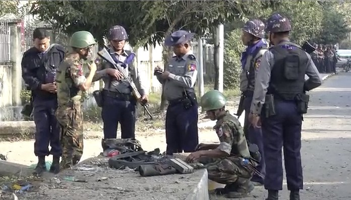 In this image made from video, police and officials inspect the site of a bomb explosion early Saturday, Feb. 24, 2018, in Sittwe, capital of Rakhine State, Myanmar. (AP Photo)