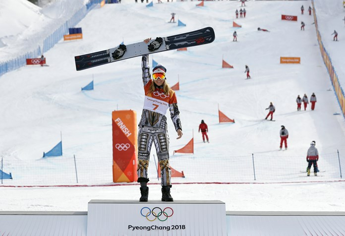 Gold medal winner Ester Ledecka, of the Czech Republic, celebrates after the women's parallel giant slalom at Phoenix Snow Park at the 2018 Winter Olympics in Pyeongchang, South Korea, Saturday, Feb. 24. (AP Photo/Lee Jin-man)