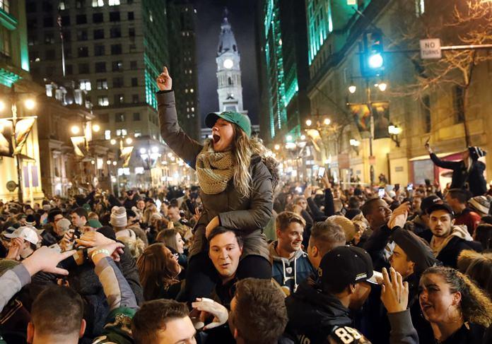 Philadelphia Eagles fans celebrate the team's victory in the NFL Super Bowl 52, Sunday, Feb. 4, in downtown Philadelphia. (AP Photo/Matt Rourke)