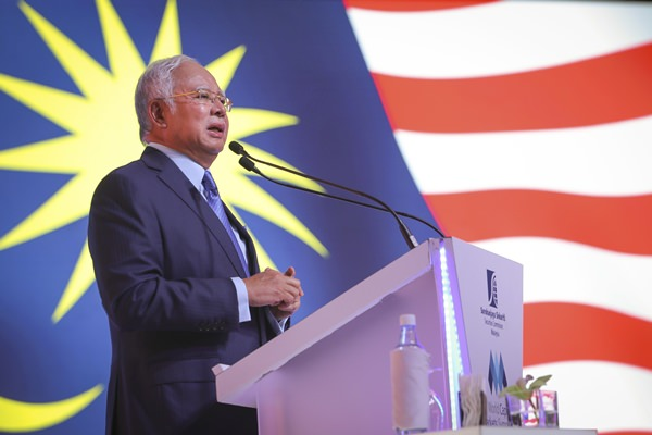 Bursa up after PM Najib announced M'sia-S'pore stock trade link