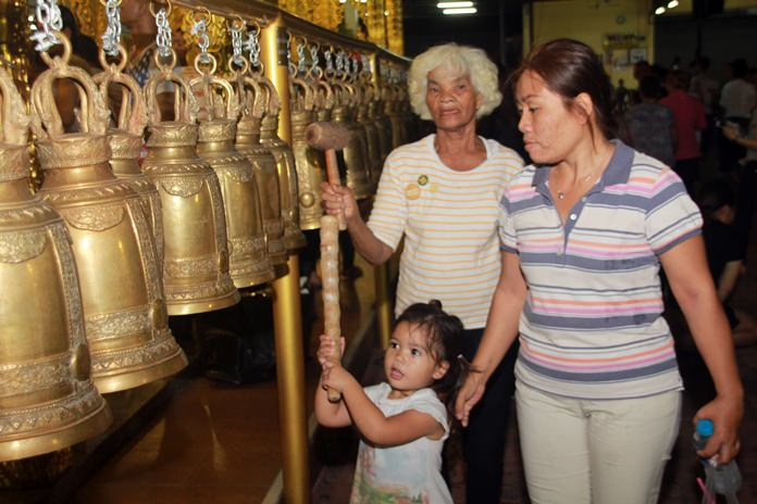 Another ritual is to ring the temple bells to cleanse the souls and drive away bad luck.