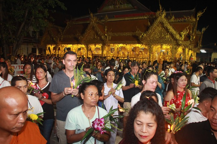 Thais and foreigners alike join to observe the religious holiday by joining in the Wien Tien activities at Wat Nong Or.