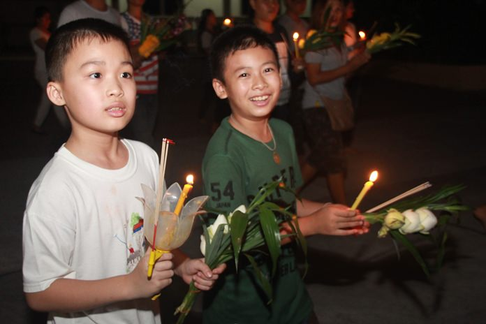 Young Thai boys enjoy themselves as they join the Wien Thien procession on Makha Bucha Day.
