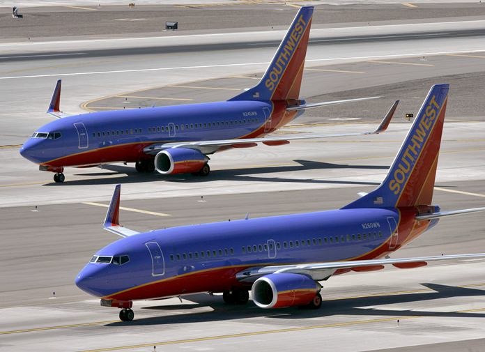 Southwest Airlines says a child was hurt by a support dog in Phoenix on Wednesday, Feb. 21, 2018, as passengers boarded a plane in Phoenix. (AP Photo/Matt York, file)