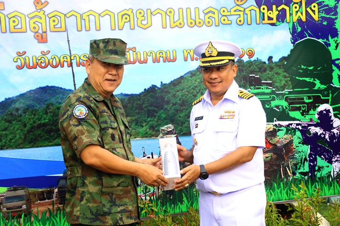Air and Coastal Defense Command Chief Rear Adm. Wara Tankham presents a gift to air patrol commander, Capt. Marudech Boonnith in celebration of the 43rd anniversary of the Royal Thai Navy's coastal air patrol unit.
