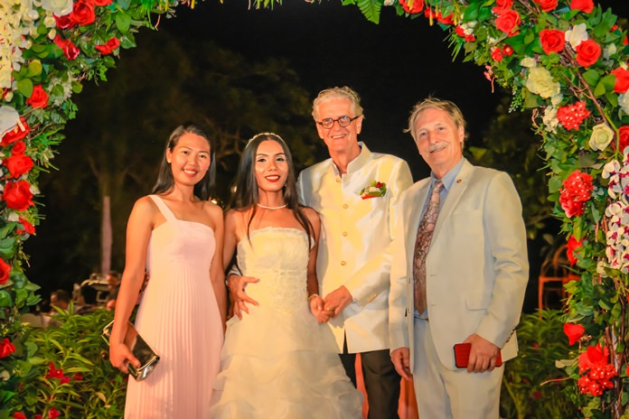 The bride and groom are flanked by Gigi and Michael Wuensche.