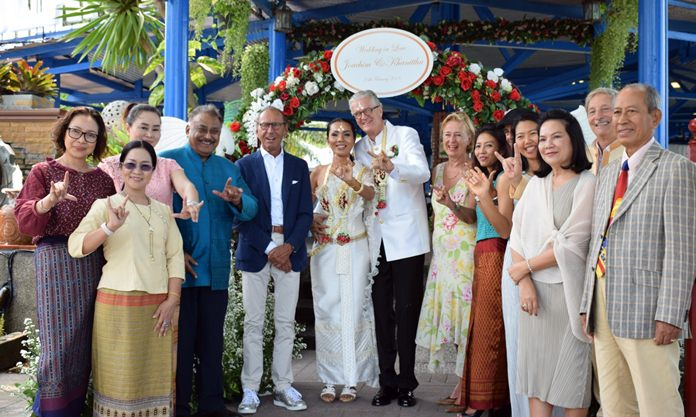 Family and friends gather for a group picture after the religious ceremonies.