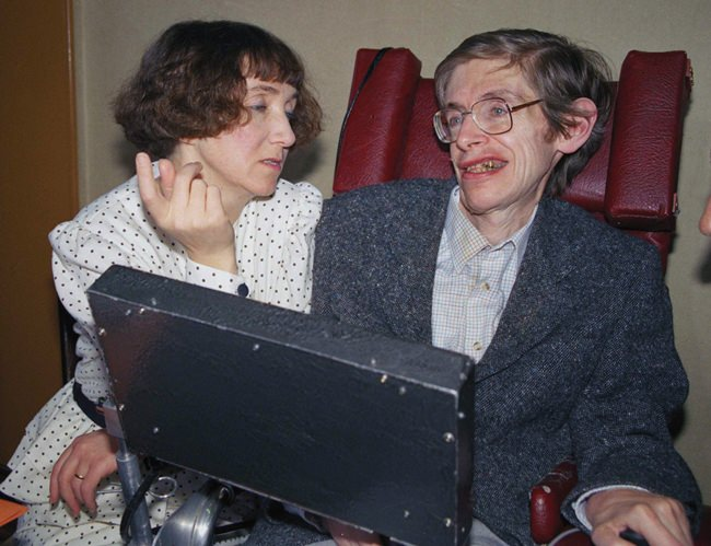 In this March 3, 1989 file photo British astrophysicist Dr. Stephen Hawking, 47, answers newsmen with the help of his computer and the assistance of his then wife Jane, in Paris. (AP Photo/Lionel Cironneau, File)