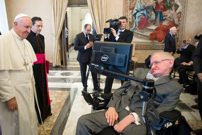 In this Monday, Nov. 28, 2016 file photo Pope Francis greets physicist Stephen Hawking during an audience with participants at a plenary session of the Pontifical Academy of Sciences, at the Vatican. (L'Osservatore Romano/pool photo via AP, File)