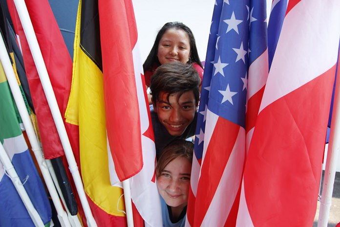 More than 40 flags were paraded by students representing their nations.