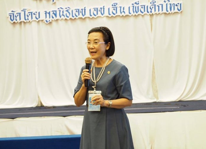 Ratchada Chomjinda, director of the HHN for Thai Children, welcomes honored guests and children to the Child Protection Card Game activities.